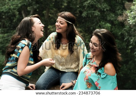 A group of three young women enjoy a day in the outdoors - stock photo