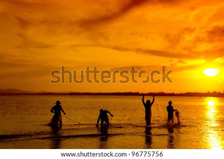 a group of traditional fisherman - stock photo