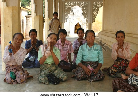 A group of women gathered at a Buddhist shrine in Bagan, Burma (Myanmar)