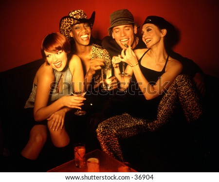 A group of young adults getting crazy in a night club. - stock photo