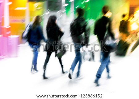 A group of young arriving passengers. Motion blur. - stock photo