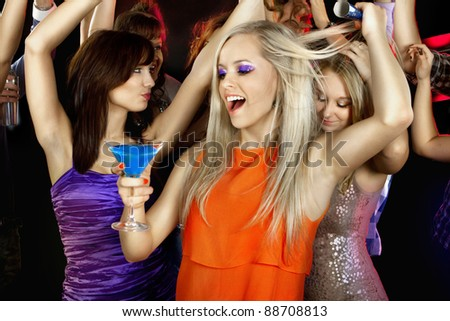 A group of young beautiful people dancing at a disco. New Year - stock photo