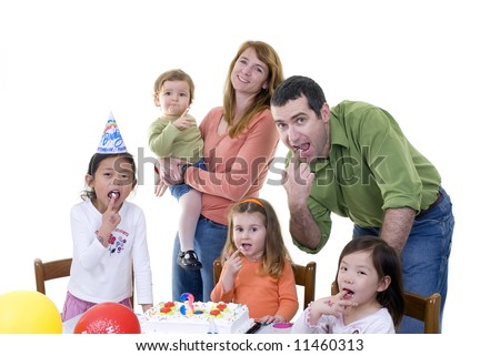 A group of young children and family celebrate a birthday party. - stock photo