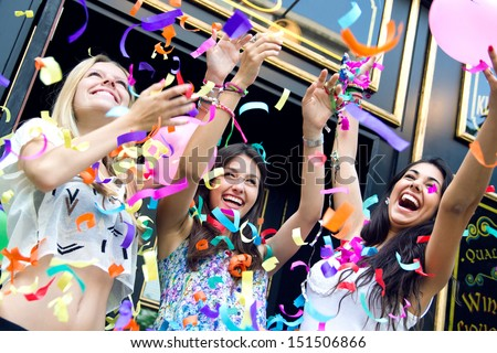 a group of young friends having a party - stock photo