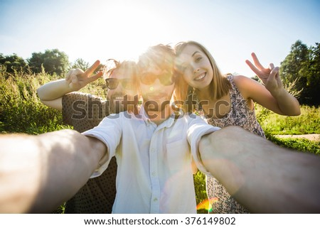 A group of young good looking multiethnic hipster friends do selfie photo portrait in Central park while summer sunset, New York - stock photo