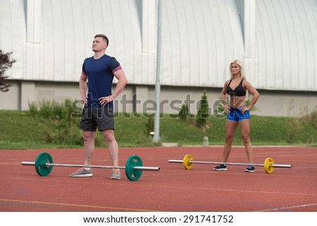 A Group Of Young People In Aerobics Class Doing A Overhead Squat Exercise Outdoor