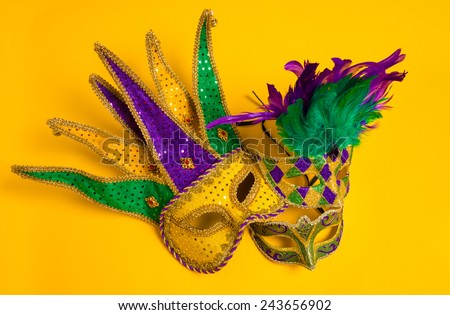 A group venetian, mardi gras mask or disguise on a yellow background - stock photo