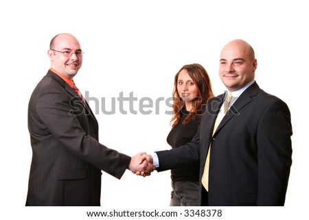 A group with two men and a woman shaking hands isolated on white - stock photo