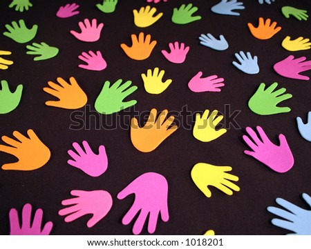 A grouping of colorful hands - stock photo