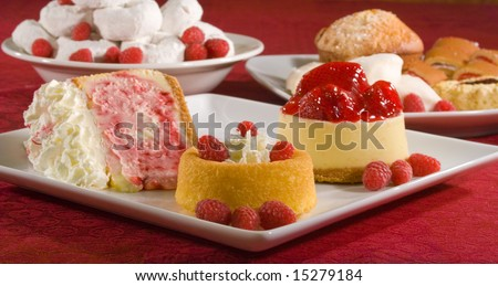 A grouping of desserts from strawberry cheesecake to powdered donuts. - stock photo