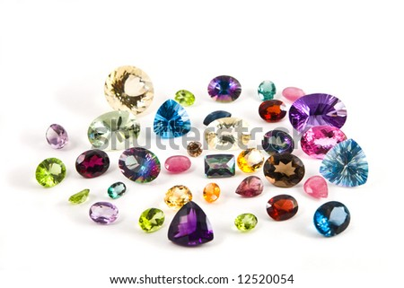 A grouping of different faceted gemstones - stock photo
