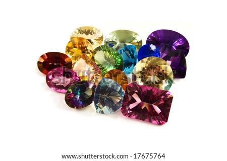 A grouping of large carat-weight gemstones on a white background - stock photo