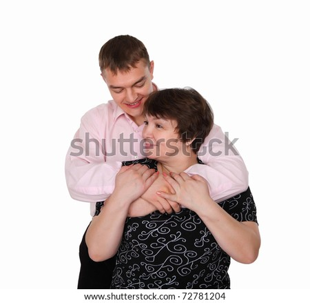 a grown-up son with his elderly mother embracing each other