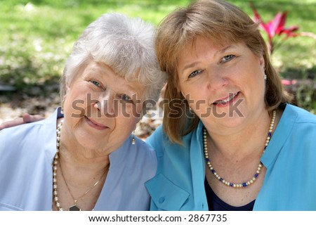 A grown woman and her senior mother.  Focus is on the adult daughter.
