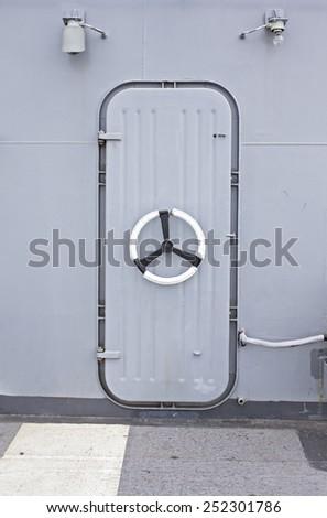 A grunge  iron door on battle ship. - stock photo