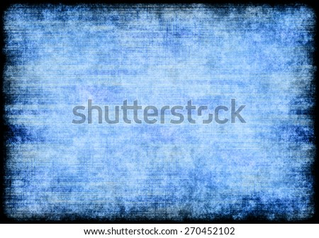A grungy abstract background in blue and white with a rough, black frame and copy space - stock photo