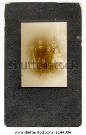 A grungy and very old embossed picture frame and photo of my great great great somebody or others!