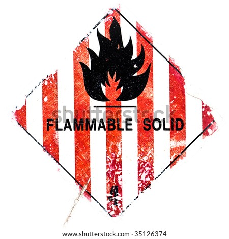 A grungy flammable solid - warning isolated on white. - stock photo