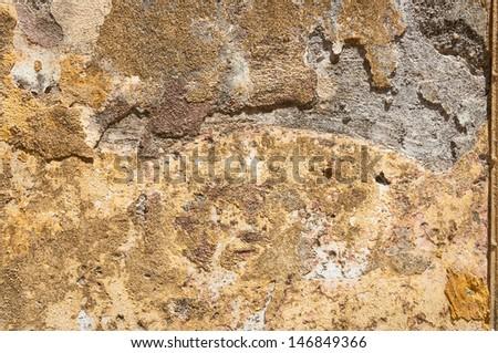 A grungy rough terracotta wall texture - stock photo