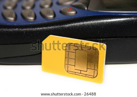 A GSM SIM card (smartcard) and a GSM mobile phone - stock photo