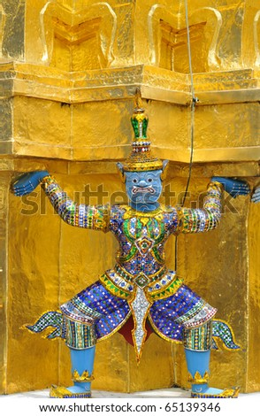 a guardian statue (yak) at the wat phra kheo temple in bangkok,thailand. - stock photo