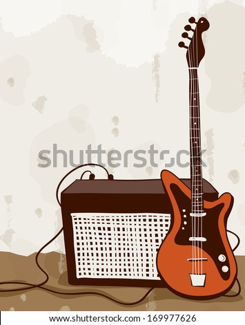 A guitar plugged into an amplifier. - stock photo