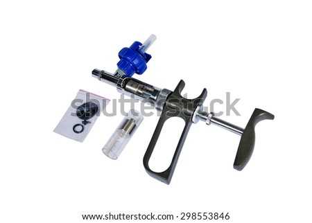 A gun for injection Cattle with accessory on a white background