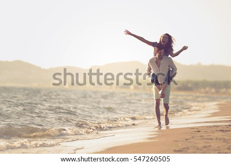 [fb] les angélus // jola&monsiame Stock-photo-a-guy-carrying-a-girl-on-his-back-at-the-beach-outdoors-547260505