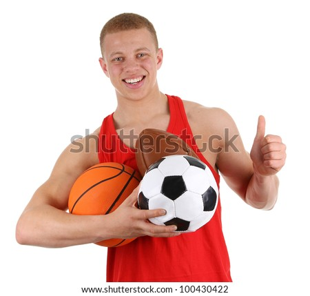 A guy holding three different sports balls, isolated on white - stock photo