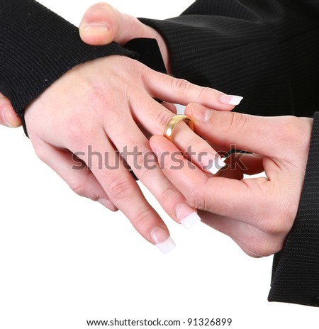 A guy putting a ring onto a girls hand