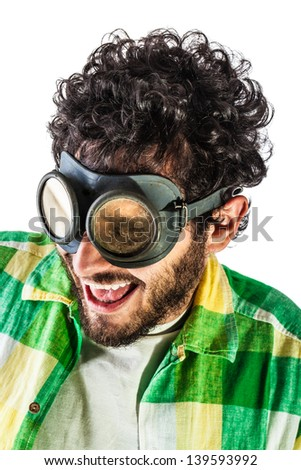 a guy wearing casual clothes and on old pair of goggles over a white bachground - stock photo