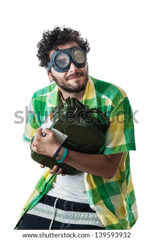 a guy wearing casual clothes and on old pair of goggles over a white bachground and stealing a fuel tank - stock photo