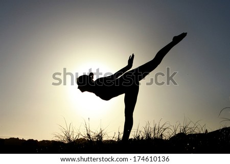 A gymnast is doing her routine on the beach in South Africa.