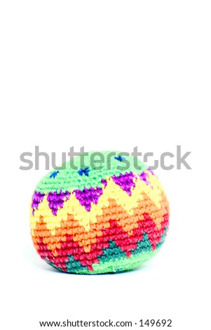 A hacky sack isolated on a white background. - stock photo