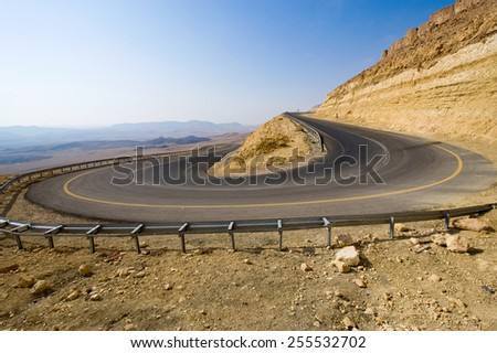 A hairpin bend on a road in the mountains of the negev desert in Israel - stock photo