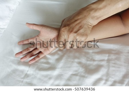A hairy man's hand holding a woman hand for rape and sexual abuse concept