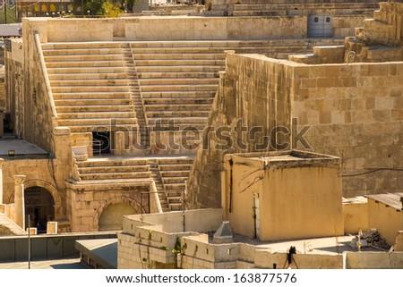 A half birds-eye view to the ancient Roman Theatre in Jordan's capital Amman - stock photo