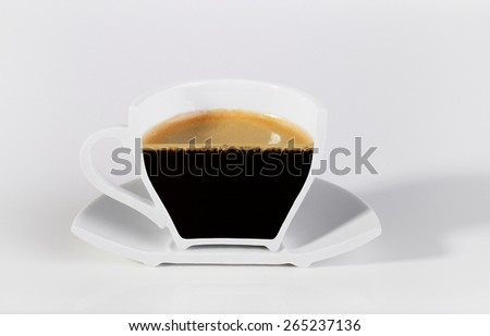 A half cup of coffee on a white background.  - stock photo