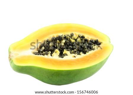 A half fresh ripe juicy papaya (carica papaya). On a white background - stock photo