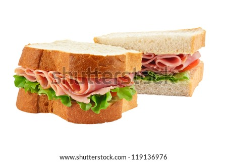 A ham salad sandwich made with freshly sliced bread cut in half with focus on the filling - stock photo