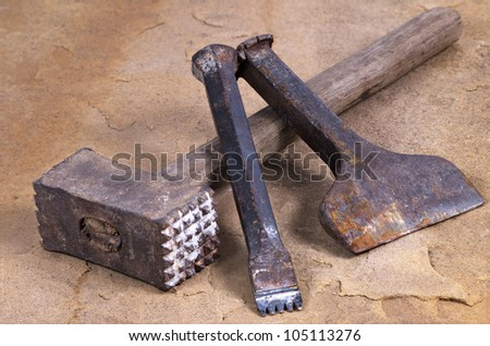 a hammer with two chisels - stock photo