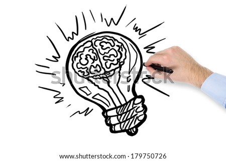 A hand and drawing a brain lamp - stock photo