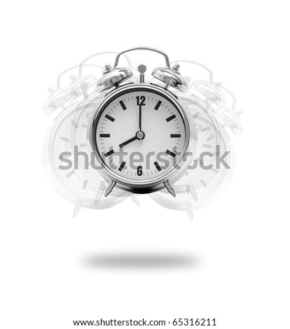A hand breaking an alarm clock - stock photo