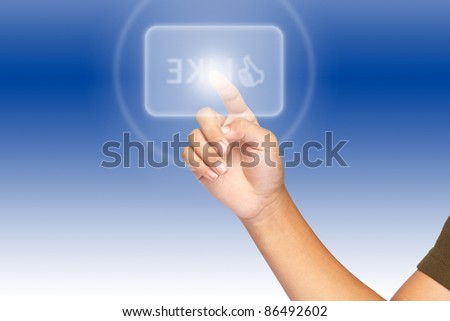 A hand click on illuminated like button - stock photo