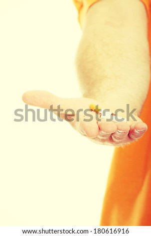 A hand crushing cigarette, isolated  - stock photo