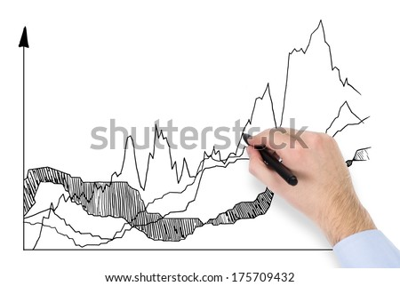 A hand drawing a graph - stock photo