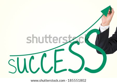 A hand drawing a successful graph - stock photo