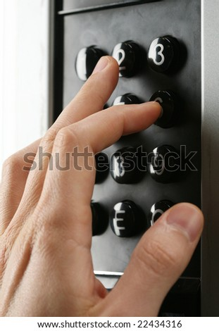a hand entering a code into the keypad