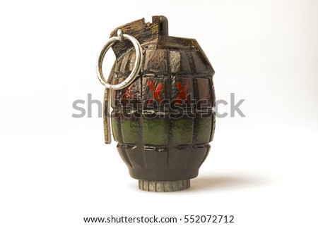 A hand grenade. This type of grenade is properly known as a Mills Bomb. It was designed by the British who used it from 1915 to 1972.