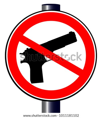 A hand gun set into a no guns allowed traffic sign
